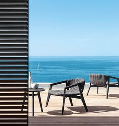 Armchair with frame in teak or in Stromboli Black mahogany and upholstery in Comfortable flat rope.