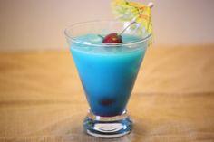 Blue Hawaiian-  1 ounce white rum  1 ounce Blue Curacao  1 ounce cream of coconut  2 ounces pineapple juice