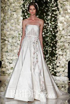 Brides.com: . Trend: Cutouts. Strapless silk A-line wedding dress with cutout bodice detail, Reem Acra