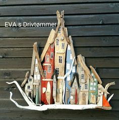 big driftwood town/houses with boat. beach art. Made by EVA s