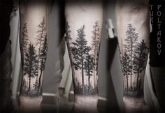 Beautiful black ink trees tattoo on forearm
