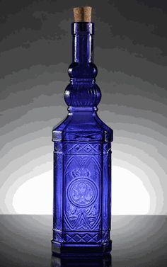 Cobalt  Blue Ornate Bottles Glass Cork Top 12   $11 each /3 for $10 each. interesting design