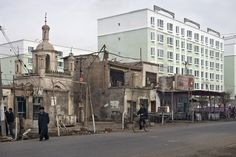 KASHGAR. A district mosque near housing blocks for Han Chinese immigrants.