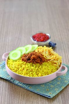 Nasi Kuning: Indonesian rice cooked with coconut milk and turmeric.