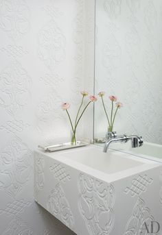 Custom-milled Corian lines the powder room of a New York apartment with architecture by Design Laboratories