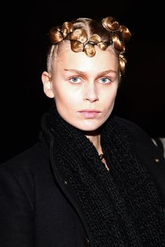 "Kimberly Ovitz: Antoinette Beenders, Aveda's global style director, created asymmetric, corseted ponytails for a ""'20s wave in a futuristic interpretation."" F/W 2013"