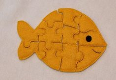 Felt fish puzzle ...This is cute and a great idea maker...make puzzles from felt using some of the other felt cuties I have here. Like dolls
