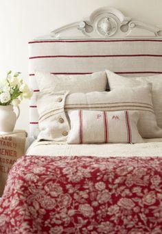 Love the striped headboard/pillows combination.