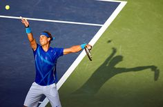 Rafael Nadal launches a serve to Novak Djokovic during the Men's Singles final of the U.S. Open.  September 2011.  #tennis
