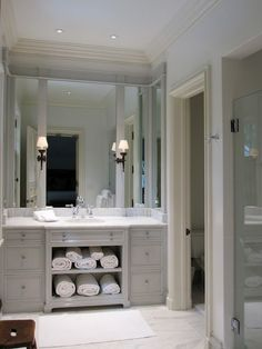 Bathroom Lights Mounted On Mirror paneling / pocket door in white master bath | beautiful home