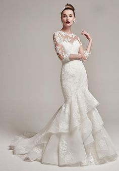 Sweetheart gown with lace motifs and layered organza skirt I Style: Moriah I by Sottero and Midgley I https://www.theknot.com/fashion/moriah-sottero-and-midgley-wedding-dress?utm_source=pinterest.com&utm_medium=social&utm_content=aug2016&utm_campaign=beauty-fashion&utm_simplereach=?sr_share=pinterest