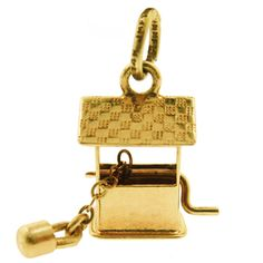 Vintage Wishing Well 14k Gold Charm  Drop a coin in the wishing well and your wish will be granted. This 14k wishing well charm has a little chain with dangling bucket. A charm full of hope and promise...