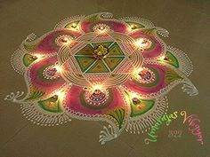 Kolam rangoli designs are made in South India. They are pretty, intricate patterns made duing festivals. Make kolam rangoli designs for Ugadi and Pongal. Indian Rangoli Designs, Small Rangoli Design, Rangoli Designs With Dots, Rangoli Designs Images, Beautiful Rangoli Designs, Rangoli Colours, Rangoli Patterns, Rangoli Ideas, Alpona Design