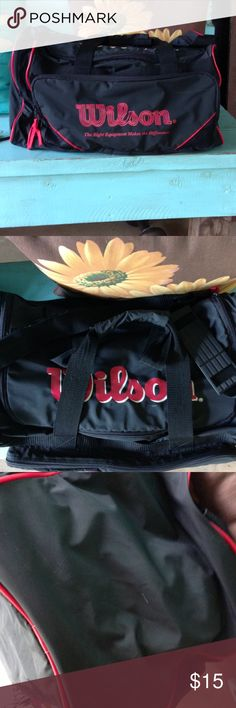 Wilson duffle bag. Wilson duffle bag, measures 20 inches long and is  11 inches tall,it is in used condition some small spots a a couple of small holes on bottom but still a great looking bag! Wilson Bags