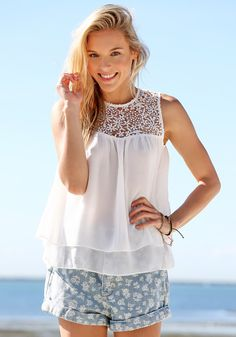 White Double Layered Chiffon - Top.Way cute sleeveless chiffon top featuring a delicate hollowed crochet lace detailing and different length double layered hem.