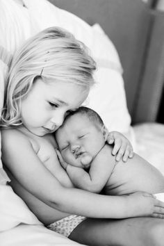 sibling love - I have a picture very similar to this of my boys. Man, what a sweet memory.   I adore them.