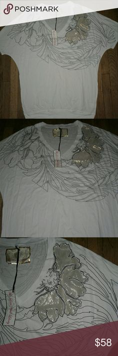 "NEW Women For L&L by Johnny Was T- Shirt NWT  (S) For Love and Liberty by Johnny Was V- Neck White Tee w/Floral Trace in Black and a Gold Emblazoned Flower w/Rhinestones. Bust 26"", Length 31"", Size (S) But it's a Very Large Small and Could Easily Pass for Large. Cotton/Modal Blend. Brand New, Never Worn. L&L by Johnny Was Tops Tees - Short Sleeve"