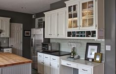 Oh So Lovely: OUR $500 DIY KITCHEN REMODEL--- concrete feather overlay, non-sanded paint for cabinets