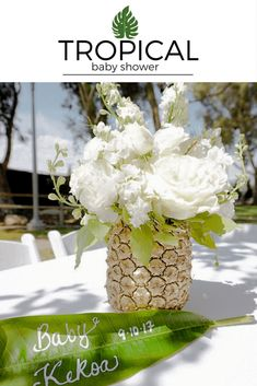 Darling Tropical Flora Baby Shower with Golden Details This is the perfect decoration for your tropical party. Golden pineapple with white flowers. Leaf detail is amazing. Hawaiian Baby Showers, Tropical Showers, Luau Baby Showers, Baby Shower Parties, Shower Party, Bridal Shower, Tropical House Design, Tropical Home Decor, Tropical Interior