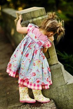 child style floral sundress, floral rubber puddlejumper rubber boots and messy ponytails