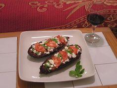 Aubergine with tomato, feta and basil