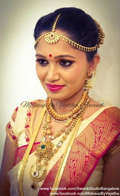 Padmavati (Rithika) looks picture perfect in her bridal avatar for her muhurtam. Makeup and hairstyle by Vejetha for Swank Studio. PHOTO CREDIT: Manish Ananda. Pink lips. Bridal hairstyle. Maang tikka. Silk sari. Bridal Saree Blouse Design. Indian Bridal Makeup. Indian Bride. Gold Jewellery. Statement Blouse. Tamil bride. Telugu bride. Kannada bride. Hindu bride. Malayalee bride. Find us at https://www.facebook.com/SwankStudioBangalore