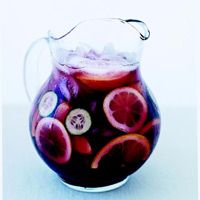 Simple Sangria  1 bottle(s) (1.5 liters) red wine  1 1/2 cup(s) fresh orange juice  1/3 cup(s) brandy  1/3 cup(s) sugar  2  (nectarines) pitted and cut into wedges  1  orange, cut in half then sliced  1  lemon, sliced  1  (Kirby (pickling) cucumber) sliced  3 cup(s) seltzer or club soda, chilled  Ice cubes