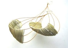 Giovanna Torricco's Alabaster hyperbola earrings. Made from vintage sequins and gold fill. Gallery Lulo.