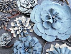 "Do you have a Guest of Honor who seems to LIVE in his or her denim blue jeans? Most Americans would put their jeans on a ""Can't Live Without"" wardrobe list. Use the ever-so-humble denim blue jeans . Denim Flowers, Fabric Flowers, Paper Flowers, Denim And Lace, Blue Denim, Blue Jeans, Jean Crafts, Denim Crafts, Denim Party"