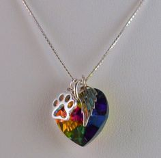 This solid Swarovski Crystal jewel necklace is an ideal way to remember your best furry friend who crossed the rainbow bridge. This necklace also makes a thoughtful gift and ships with a complimentary gift bag for each one you order.