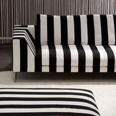 marimekko stripe fabric on a sofa via little augury
