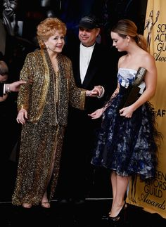 Billie Lourd Photos Photos - (L-R) Actress Debbie Reynolds, recipient of the Screen Actors Guild Life Achievement Award, Todd Fisher and actress Billie Lourd walk into the press room at the 21st Annual Screen Actors Guild Awards at The Shrine Auditorium on January 25, 2015 in Los Angeles, California. - 21st Annual Screen Actors Guild Awards - Press Room