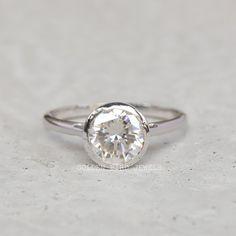 #ColorlessMoissanite #MoissaniteRing #DiamondWeddingSet #WeddingGiftForHer #WeddingRingForHer #DiamondWeddingRing #GoldRing #BezelSetRing #DiamondRing #MoissaniteDiamond #SolitaireRing #GoldBridalRingSet #RoundShapedRing