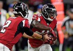 Atlanta Falcons quarterback Matt Ryan (2) hands off to running back Tevin Coleman (26) in the first half of an NFL football game in New Orleans, Monday, Sept. 26, 2016.