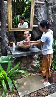 Baby Bath -- Thailand. I attended my 2nd birth in Thailand, then went on to become a midwife.