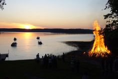 Juhannus (mid-summer's night) celebration in Finland. I always remember the bonfires and family grilling sausages.