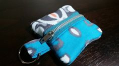 Check out this item in my Etsy shop https://www.etsy.com/listing/221576652/damask-printed-earbud-zipper-pouch