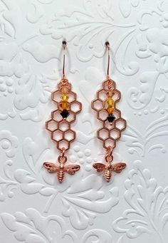 Shiny copper bee and honeycomb earring and necklace set. Accented with black, copper and yellow Swarovski crystals. Chain is 18 inches. Pendant and earrings are 2 inches Ladybug Jewelry, Christmas Tree Earrings, Earring Tree, White Stone, Honeycomb, Necklace Set, Bees, Swarovski Crystals, Copper