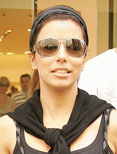 Eva Longoria wearing Prada sunglasses #Prada - www.vingerhoets-optics.be