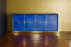 Luxury sideboard in blue veneer with gold plated handles, plinth and door trims. Satinwood inlay and mother of pearl. Designed to match unique embossed leather floor