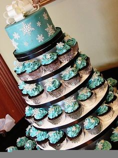 Like this idea of small cake with cupcakes; change the blue to purple and keep the silver