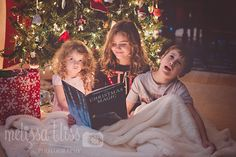 I like her ideas for setting up a Christmas photo. Use a flashlight behind the book to light up their faces.