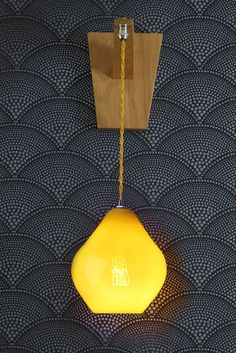 The Acid Drop Deco Wall Light, allowing the intricate filament to show through the Canary glass