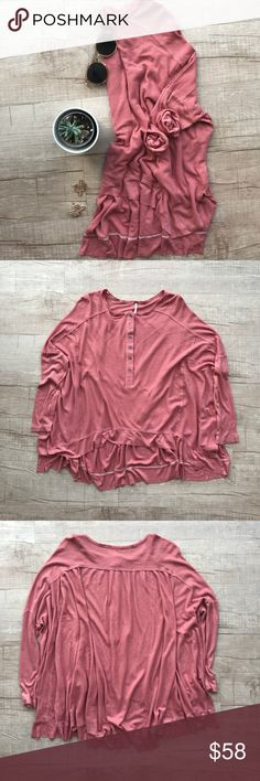 "Free People Benedict Canton Henley Thermal Top * Free People ""Benedict Canyon Henley Long Sleeve Thermal"" * color ""Wood Rose"" * flowy/relaxed fit * raw hem for added style * half button closure * thin knitted thermal * BUST (laid flat, on one side) - 25"" * LENGTH - 23"" (front) / 29"" (back)  * 88% Rayon, 12% Linen * extra buttons are still attached  * please note, there are two very small stains on the left cuff, but are hardly noticeable when worn.  * all measurements are approximate  * no…"