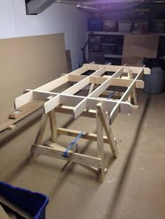 Plywood Cutting Table by Skippy906 -- Homemade plywood cutting table comprised of a plywood frame mounted on two folding sawhorses. http://www.homemadetools.net/homemade-plywood-cutting-table-2