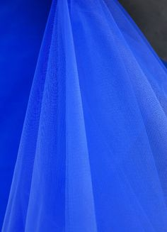 """Fine Tulle Bolt Royal Blue Tulle 54"""" wide  40 yards $17.50 for the church pews. draping from one to the other? or you could do a silver? then each pew have that wreath thing you want?"""