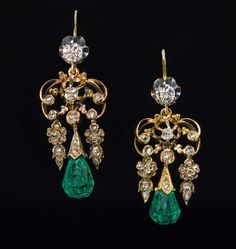 Antique 14K gold dangle earrings featuring two old briolette cut emeralds of a bluish-green color and old mine and rose cut diamonds.