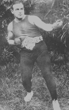 "Tommy Burns (June 17, 1881 – May 10, 1955), born Noah Brusso, is the only Canadian born world heavyweight champion boxer. The first to travel the globe in defending his title, Tommy made 11 title defenses despite often being the underdog due to his size. Burns famously challenged all comers as Heavyweight Champion, leading to a celebrated bout with African-American Jack Johnson.[1] According to his biographer, Burns insisted, ""I will defend my title against all comers, none barred. By this I mean white, black, Mexican, Indian, or any other nationality. I propose to be the champion of the world, not the white, or the Canadian, or the American. If I am not the best man in the heavyweight division, I don't want the title.""  Burns was also the first heavyweight champion to give a Jewish boxer a shot at the crown. Burns defeated Joseph 'Jewey' Smith in a fight staged in Paris. He also fought a bout with a Native American on his way to the Championship. According to one biography, he also had two black sparring partners and was married for a brief time to a black woman. At a time when most white fighters adhered to the so-called ""color-line"", refusing to fight African Americans, Burns had half a dozen contests with black boxers prior to his clash with the legendary Jack Johnson."