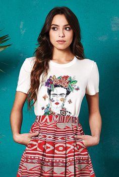 <ul><li>Super soft viscose jersey</li><li>Studio-designed Frida Kahlo illustration</li><li>Round neck</li><li>Short sleeves</li><li>Slim fit</li></ul><p>Features:</p><p>Lengths: Size 8: 55cm, Size 10: 56cm, Size 12: 57cm, Size 14: 57cm, Size 16: 58cm</p>