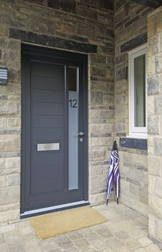 Contemporary Dowr style entrance door finished in Warwick Stone. Stainless Steel ironmongery from The Coastal Group. Sandblasted effect vision panel with etched house number. Manufactured in Engineered European Redwood. Timber Front Door, Double Front Doors, Glass Front Door, Sliding Glass Door, Purple Front Doors, Front Door Colors, Front Door Decor, Front Porch, Entrance Doors